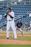 Montgomery Biscuits designated hitter Brendan McKay (38) leads off first base as pitcher Devin Williams (14) gets ready to deliver a pitch during Southern League game against the Biloxi Shuckers on May 8, 2019 at MGM Park in Biloxi, Mississippi.  Biloxi defeated Montgomery 4-2.  (Mike Janes/Four Seam Images)
