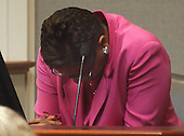 Isa Nichols, clasps her hands and lowers her head after viewing an autopsy photo of her niece during the penalty phase in the trial of convicted sniper John Allen Muhammad in courtroom 10 at the Virginia Beach Circuit Court in Virginia Beach, Virginia on November 17, 2003.  Muhammad was found guilty of capital murder, terrorism, conspiracy and a firearms violation. <br /> Credit: Dave Ellis - Pool via CNP