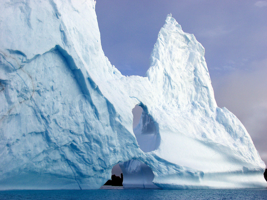 .A large iceberg lodged in the bottom of Maxwell Bay in 450 feet of water off King George Island, Antarctica.