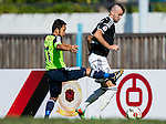 Petrisor Voinea of Sun Pegasus FC (R) competes for the ball with Kin Wai Sze of Wofoo Tai Po (L) during the HKFA Premier League between Wofoo Tai Po vs Sun Pegasus at the Tai Po Sports Ground on 22 November 2014 in Hong Kong, China. Photo by Aitor Alcalde / Power Sport Images