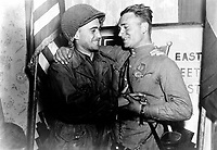 Happy 2nd Lt. William Robertson and Lt. Alexander Sylvashko, Russian Army, shown in front of sign (East Meets West) symbolizing the historic meeting of the Russian and American Armies, near Torgau, Germany. April 25, 1945. Pfc. William E. Poulson. (Army)<br /> NARA FILE #:  111-SC-205228<br /> WAR & CONFLICT #:  1096