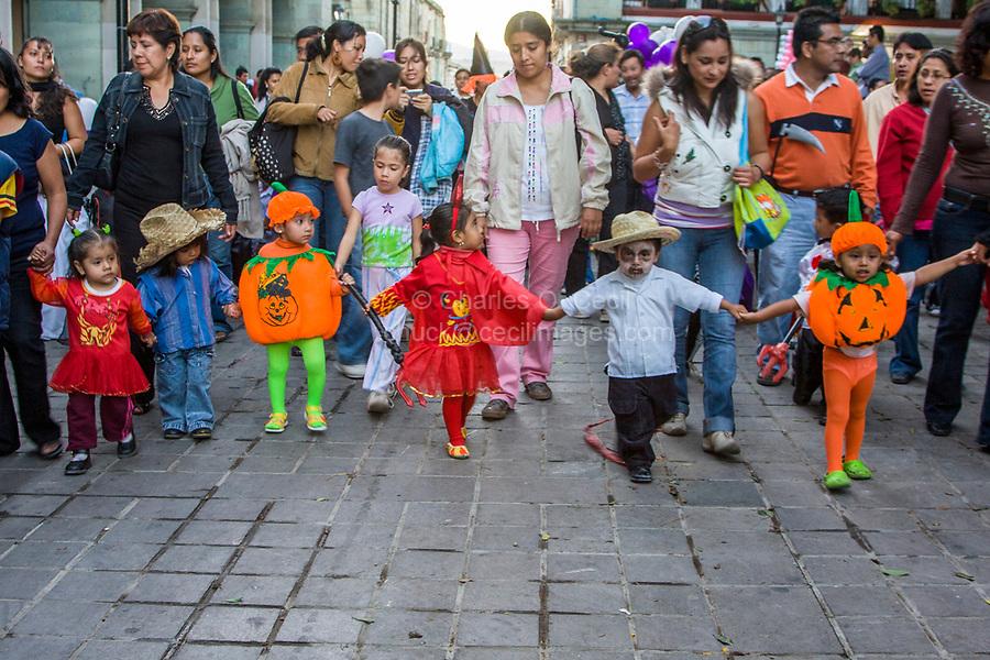 "Oaxaca, Mexico, North America.  Day of the Dead Celebrations.  Children's ""Comparsa"", a Costumed Procession at the Zocalo, or Town Square."
