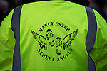 © Joel Goodman - 07973 332324 . 19/12/2014 .  Manchester , UK . A Manchester Street Angel patrolling in Manchester City Centre this afternoon (Friday 19th December 2014) ahead of Mad Friday night . Street angels are volunteers who patrol and help out vulnerable and distressed revellers . Police say a hundred police will be patrolling in Manchester City Centre this evening (Friday 19th December) after previous reports have said as few as four have been available some nights . Photo credit : Joel Goodman/LNP