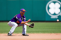 Trentt Copeland (14) of the Evansville Purple Aces fields a ground ball during a game against the Missouri State Bears at Hammons Field on May 12, 2012 in Springfield, Missouri. (David Welker/Four Seam Images)