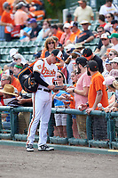 Baltimore Orioles first baseman Trey Mancini (67) signs autographs before a Spring Training exhibition game against the Dominican Republic on March 7, 2017 at Ed Smith Stadium in Sarasota, Florida.  Baltimore defeated the Dominican Republic 5-4.  (Mike Janes/Four Seam Images)