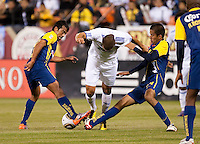 Karim Benzema dribbles through Club America players. Real Madrid defeated Club America 3-2 at Candlestick Park in San Francisco, California on August 4th, 2010.