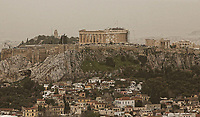 Pictured: Reduced visibility due to red dust over the Acropolis in Athens Greece. Monday 26 March 2018<br /> Re: Strong southern winds from Africa have carried red dust over to Greece.
