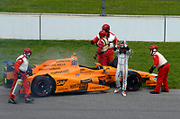 Fernando Alonso, McLaren-Honda-Andretti Honda reacts as he climbs from his car after retiring from the Indy 500.