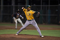 AZL Athletics relief pitcher Jesus Monserratt (52) delivers a pitch during an Arizona League game against the AZL Giants Black at the San Francisco Giants Training Complex on June 19, 2018 in Scottsdale, Arizona. AZL Athletics defeated AZL Giants Black 8-3. (Zachary Lucy/Four Seam Images)