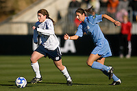 Notre Dame Fighting Irish midfielder Courtney Barg (17) is chased by North Carolina Tar Heels midfielder Yael Averbuch (17). The North Carolina Tar Heels defeated the Notre Dame Fighting Irish 2-1 during the finals of the NCAA Women's College Cup at Wakemed Soccer Park in Cary, NC, on December 7, 2008. Photo by Howard C. Smith/isiphotos.com