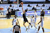 CHAPEL HILL, NC - FEBRUARY 24: Dawson Garcia #33 of Marquette shoots a layup during a game between Marquette and North Carolina at Dean E. Smith Center on February 24, 2021 in Chapel Hill, North Carolina.