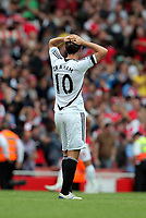 Pictured: Danny Graham of Swansea is holding his head in disappointment after the final whistle. Saturday 10 September 2011<br />