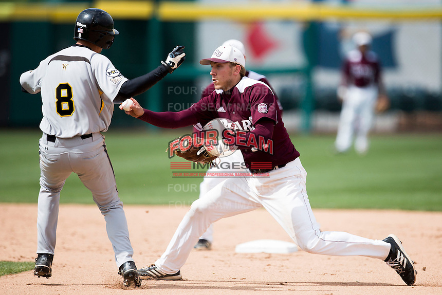 Eric Cheray #14 of the Missouri State Bears tags a base runner during a game against the Wichita State Shockers at Hammons Field on May 5, 2013 in Springfield, Missouri. (David Welker/Four Seam Images)