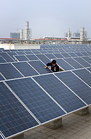 CHINA. Solar panels on top of the Yingli Solar company facility, in Baoding City. 2011