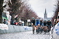 peloton up the cobbles of the Gitsberg.<br /> <br /> GP Monseré 2020<br /> One Day Race: Hooglede – Roeselare 196.8km. (UCI 1.1)<br /> Bingoal Cycling Cup 2020