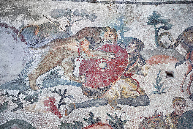 Ambulatory of the Great Hunt Roman mosaic, room no 28, at the Villa Romana del Casale, first quarter of the 4th century AD. Sicily, Italy. A UNESCO World Heritage Site.<br /> <br /> The Great Hunt ambulatory is around 60 meters long (200 Roman feet) and connects the master's northern apartments with the triclinium in the south. The door in the centre of the the Great Hunt ambulatory leads to audience hall. <br /> <br /> The Great Hunt Roman mosaic depicts African animals being hunted and put onto ships to be taken to the Colosseum.