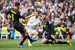 Cristiano Ronaldo of Real Madrid fights for the ball with David Lopez of RCD Espanyol and Oscar Duarte of RCD Espanyol  during the match Real Madrid vs RCD Espanyol, a La Liga match at the Santiago Bernabeu Stadium on 18 February 2017 in Madrid, Spain. Photo by Diego Gonzalez Souto / Power Sport Images