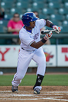 Round Rock Express shortstop Yeyson Yrizarri (60) squares to bunt during the Pacific Coast League baseball game against the Oklahoma City Dodgers on June 9, 2015 at the Dell Diamond in Round Rock, Texas. The Dodgers defeated the Express 6-3. (Andrew Woolley/Four Seam Images)