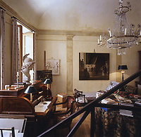 View of the 'salon-atelier' over the balustrade of the staircase leading up to the master bedroom.