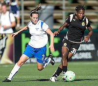 SANTA CLARA, CA--Formiga holds possession against Kelly Shmedes during the 1-0 loss to the Boston Breakers.  Sunday, July 19, 2009.