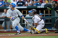 UCLA shortstop Pat Valaika (10) follows through on his swing during Game 1 of the 2013 Men's College World Series Finals against the Mississippi State Bulldogs on June 24, 2013 at TD Ameritrade Park in Omaha, Nebraska. The Bruins defeated the Bulldogs 3-1, taking a 1-0 lead in the best of 3 series. (Andrew Woolley/Four Seam Images)