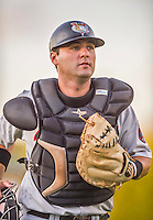 20 August 2015: Tri-City ValleyCats catcher Anthony Hermelyn returns to the dugout after warming up his pitcher prior to a game against the Vermont Lake Monsters at Centennial Field in Burlington, Vermont. The Stedler Division-leading ValleyCats defeated the Lake Monsters 5-2 in NY Penn League action. Mandatory Credit: Ed Wolfstein Photo *** RAW Image File Available ****