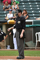 Home plate umpire Kolin Kline during the game as the Salt Lake Bees played the Reno Aces in Pacific Coast League action at Smith's Ballpark on May 5, 2014 in Salt Lake City, Utah.  (Stephen Smith/Four Seam Images)