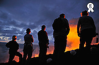 People watching lava flowing to the sea (Licence this image exclusively with Getty: http://www.gettyimages.com/detail/83749925 )