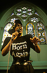 Born again Christian, young Black British teenager singing in church. Church of God of Prophecy Brixton, London England 1990s.