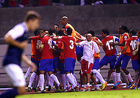 SAN JOSE, COSTA RICA - September 06, 2013: Players of the Costa Rica MNT celebrate their first goal during a 2014 World Cup qualifying match against the USA MNT at the National Stadium in San Jose on September 6. USA lost 3-1.