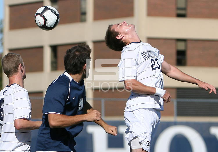 Ben Slingerland #23 of Georgetwn University heads back over Dylan Renna #9 of Villanova University during a Big East match at North Kehoe Field, Georgetown University on October16 2010 in Washington D.C. Georgetown won 3-1.