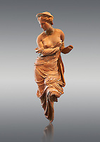 Heyl Statue of Aphrodite, Greek goddess of love. 2nd century terracotta from the Heyl collection. This statuette is one of the most beautiful examples of ancient terracotta statues in existence. The close fitting robe or the goddess of love has slipped from her shoulders, her raised left leg perhaps stood on a pillar. The front of the figure, which was shaped in a mould, was carved using a modelling scraper and finally painted. Altes Museum Berlin