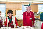 Waterbury, CT- 25 December 2016-122516CM04- Husband and wife, Lorraine Brandolini and Ed Clark, both volunteers serve up meals during a Joy of Christmas Dinner at the First Congregational Church in Waterbury.     Christopher Massa Republican-American