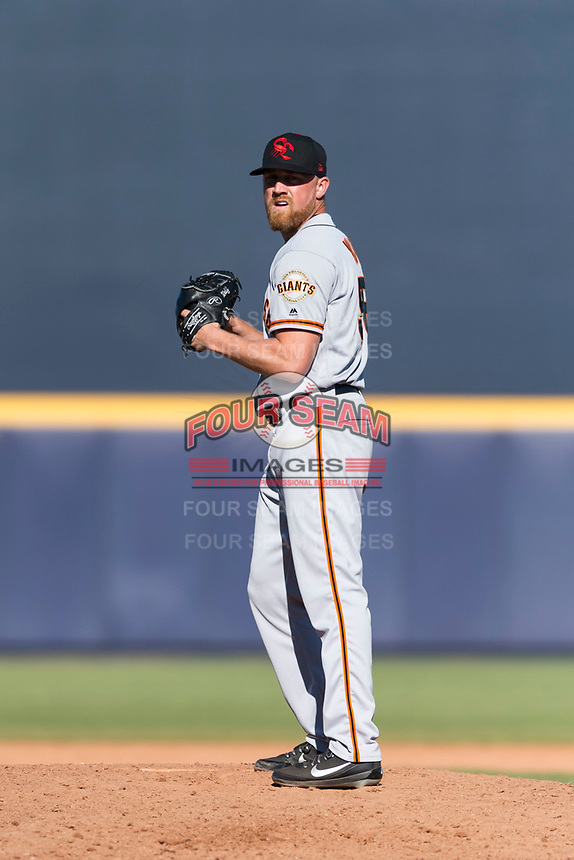 Scottsdale Scorpions relief pitcher Sam Wolff (56), of the San Francisco Giants organization, gets ready to deliver a pitch during an Arizona Fall League game against the Peoria Javelinas at Peoria Sports Complex on October 18, 2018 in Peoria, Arizona. Scottsdale defeated Peoria 8-0. (Zachary Lucy/Four Seam Images)