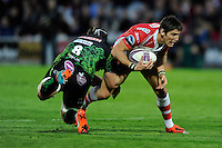 James Hook of Gloucester Rugby is tackled by Tom Waldrom of Exeter Chiefs during the European Rugby Challenge Cup semi final match between Gloucester Rugby and Exeter Chiefs at Kingsholm Stadium on Saturday 18th April 2015 (Photo by Rob Munro)