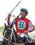 30 January 2010: Manoel Cruz celebrates after winning the Sunshine Millions Distaff Stakes riding Sweet Repent at Gulfstream Park in Hallandale Beach, FL.