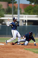 Milwaukee Brewers Gilbert Lara (24) throws to first as Gabriel Mejia (1) slides into second during an instructional league game against the Cleveland Indians on October 8, 2015 at the Maryvale Baseball Complex in Maryvale, Arizona.  (Mike Janes/Four Seam Images)