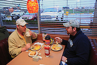 Rich, David Hackenberg's driver, can finally have breakfast after 90 hours of non-stop traveling. .