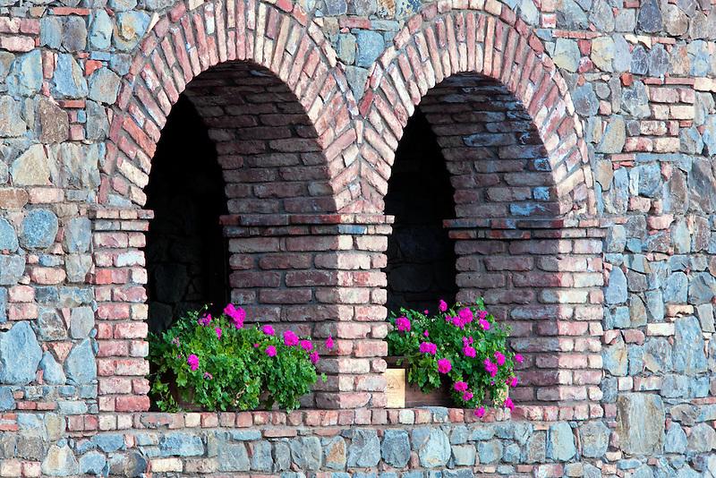 Begonias in window opening. Castello di Amerorosa. Napa Valley, California. Property relased