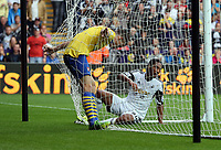 Saturday 28 September 2013<br /> Pictured: Jonathan de Guzman of Swansea (R) in the Arsenal nets after a team mate's cross.<br /> Re: Barclay's Premier League, Swansea City FC v Arsenal at the Liberty Stadium, south Wales.