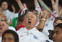 An England fan sings along to the England national anthem before the 2010 World Cup first round match between USA and England in Rustenberg, South Africa on Saturday, June 12, 2010.