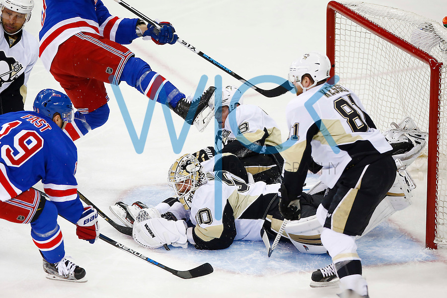Brian Dumoulin #8 of the Pittsburgh Penguins slides into Matt Murray #30 of the Pittsburgh Penguins in the first period against the New York Rangers during game four of the first round of the Stanley Cup Playoffs at Madison Square Garden in New York City on April 21, 2016. (Photo by Jared Wickerham / DKPS)