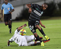 BOGOTA -COLOMBIA, 1 -SEPTIEMBRE-2014. Daniel Briceño ( I) de La Equidad  F.C. disputa el balón con  Miller Mosquera D ) del Atletico Nacional  durante partido de la  septima  fecha  de La Liga Postobón 2014-2. Estadio Nemesio Camacho El Campin . / Daniel Briceño (L) of Equidad FC    fights for the ball with Miller Mosquera of Atletico Nacional    during match of the 7th date of Postobon  League 2014-2. El Campin  Stadium. Photo: VizzorImage / Felipe Caicedo / Staff