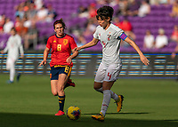 ORLANDO, FL - MARCH 05: Saki Kumagai #4 of Japan passes the ball during a game between Spain and Japan at Exploria Stadium on March 05, 2020 in Orlando, Florida.