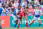 Harry Jones of Canada (C) is tackled by Tavite Veredamu of France (L)  during the HSBC Hong Kong Sevens 2018 Bowl Final match between Canada and France on 08 April 2018, in Hong Kong, Hong Kong. Photo by Marcio Rodrigo Machado / Power Sport Images