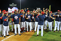 Greenville Drive players celebrate their 2017 South Atlantic League Championship as manager Darren Fenster delivers the trophy following an 8-3 win over the Kannapolis Intimidators in Game 4 of the Championship Series on Friday, September 15, 2017, at Fluor Field at the West End in Greenville, South Carolina. It was Greenville's first SAL Championship. Greenville won the series 3-1. (Tom Priddy/Four Seam Images)
