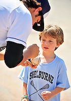 15 July 2010: Vermont Lake Monsters' pitcher Mark Herrera autographs a baseball for a young fan  prior to a game against the Aberdeen IronBirds at Centennial Field in Burlington, Vermont. The Lake Monsters rallied in the bottom of the 9th inning to defeat the IronBirds 7-6 notching their league leading 20th win of the 2010 NY Penn League season. Mandatory Credit: Ed Wolfstein Photo