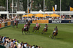 Mint Polo in the Park. Hurlingham Park Fulham London Uk June 6th 2010. London Uk June 6th 2010. City AM Team New York (blue) IG Index Team Paris ( pink)