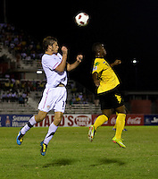 Zachary Carroll (17) of the United States goes up for a header with Jason Wright (10) of Jamaica during the semifinals of the CONCACAF Men's Under 17 Championship at Catherine Hall Stadium in Montego Bay, Jamaica. The United States defeated Jamaica, 2-0.