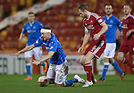 Aberdeen v St Johnstone...01.01.15   SPFL<br /> Steven MacLean is fouled by Mark Reynolds<br /> Picture by Graeme Hart.<br /> Copyright Perthshire Picture Agency<br /> Tel: 01738 623350  Mobile: 07990 594431